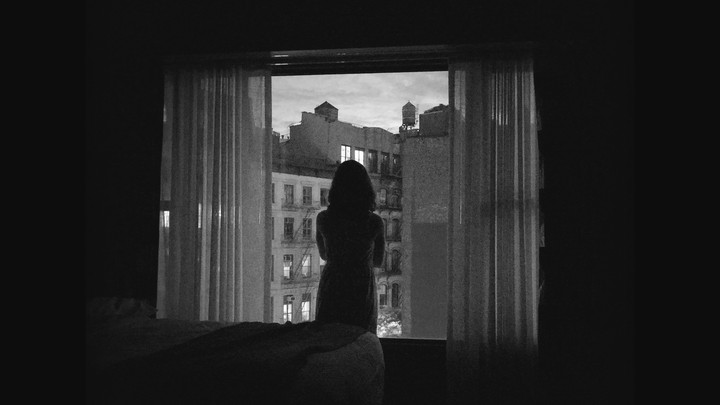 A girl looking out the window.