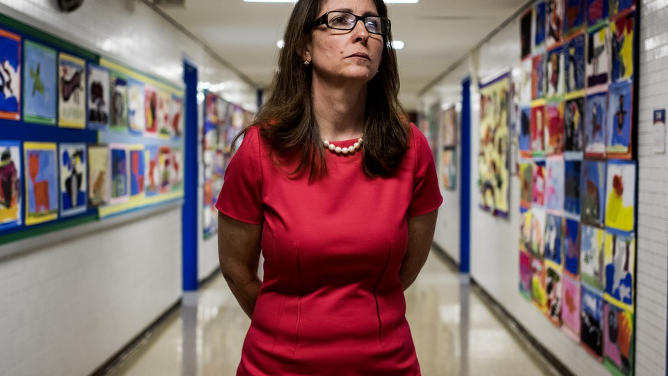 Eva Moskowitz looks sternly into the distance in a hallway in one of Success Academy's Harlem schools.