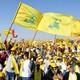 Supporters of Lebanon's Hezbollah leader Sayyed Hassan Nasrallah display Hezbollah and Lebanese flags.