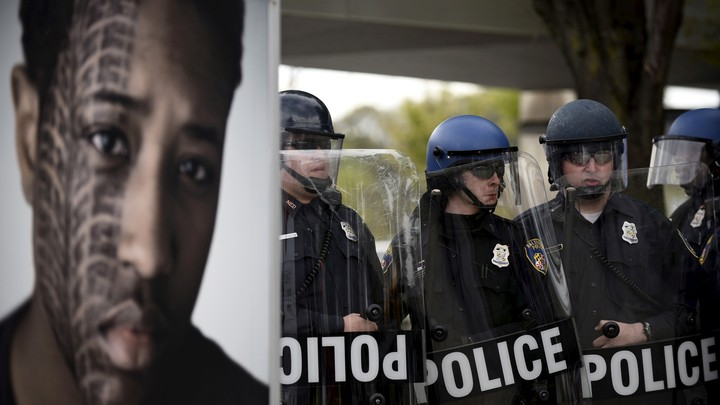 Baltimore police form a line during clashes with protesters after Freddie Gray's funeral in 2015.