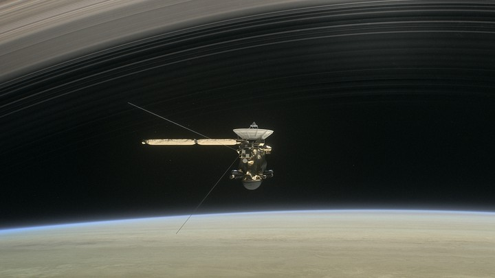 An artist's illustration of Cassini between Saturn and the planet's innermost rings