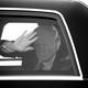 Trump waving from a car
