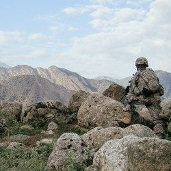 A soldier from the 101st Airborne Division patrols the Pech Valley in 2010