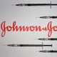 Vaccine needles surrounding the Johnson & Johnson logo