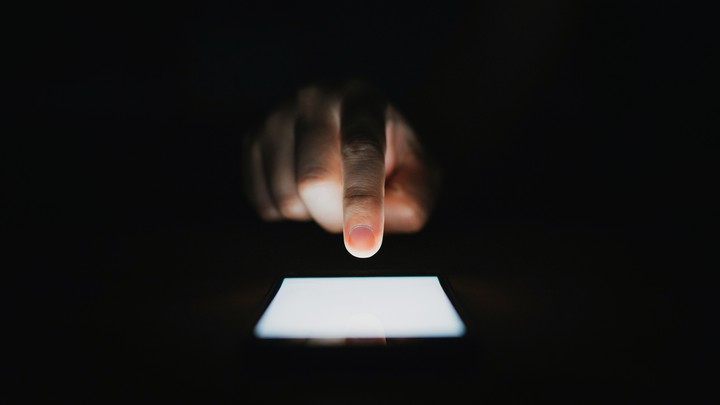 A person types on a smartphone.