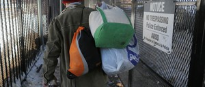 Mack Donohue, who has been homeless since 2008, carries his belongings into a shelter in Boston, Massachusetts February 27, 2015.