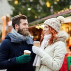 photo: a couple in a Christmas market.