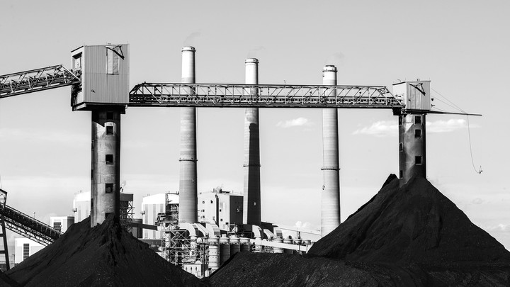 Large coal piles sit in front of PacifiCorps, a power plant in Castle Dale, Utah, in June 2019
