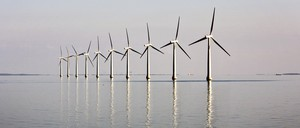 A line of wind turbines in the water