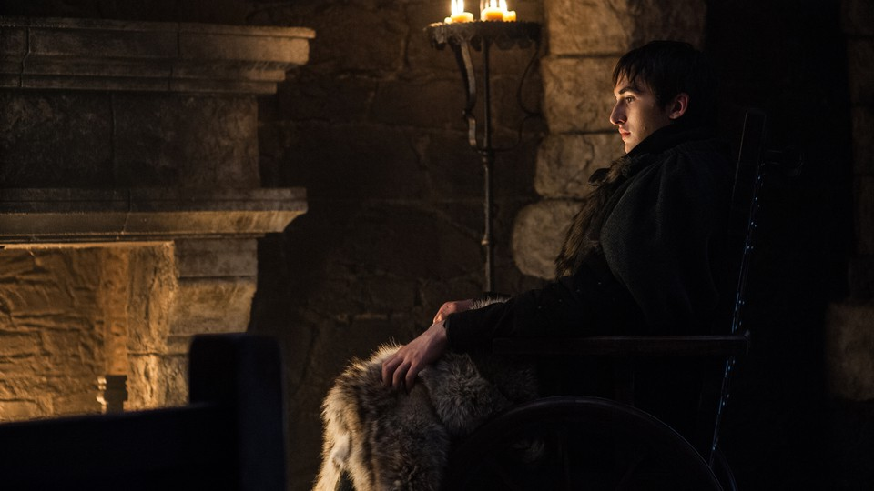 Bran Stark sitting before a fire on 'Game of Thrones'