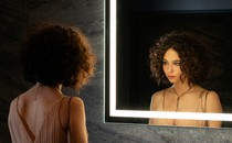 photograph of Elena Alves looking in the mirror