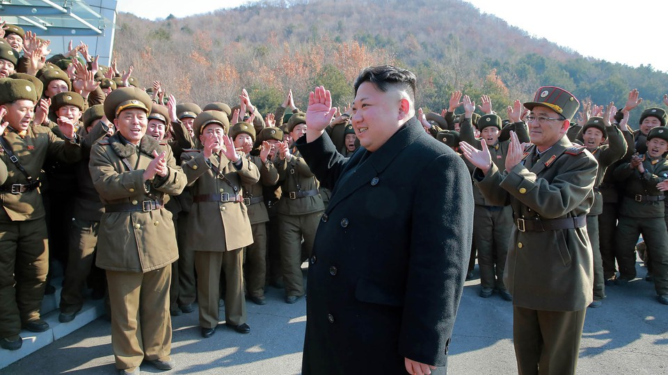 North Korean leader Kim Jong Un waving to North Korean officers during the launch of ballistic missiles