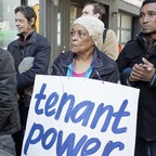 a photo of a group of tenants at a press conference in New York City