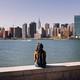 A young woman gazes at Manhattan's skyline