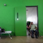A man who lost his home during Hurricane Maria sits in a wheelchair at a school turned shelter in 2017.
