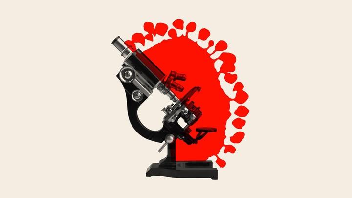An illustration of a microscope and coronavirus.