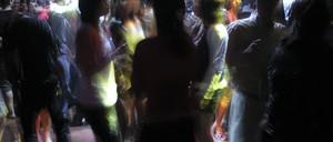 People dance in a nightclub.