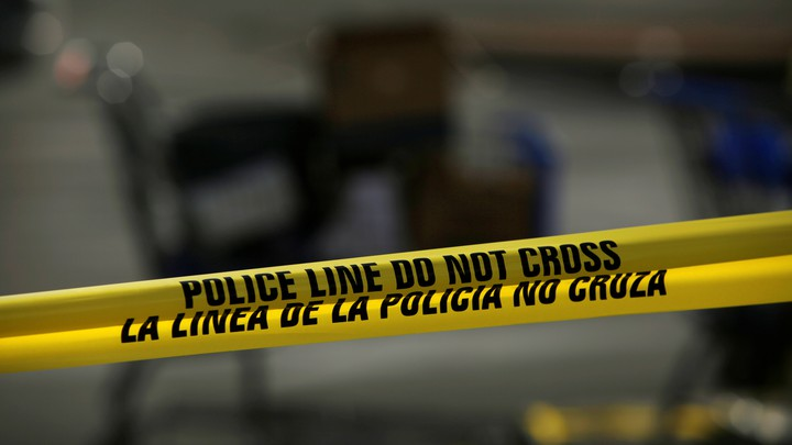 A yellow-and-black police cordon is seen after a mass shooting in El Paso, Texas.
