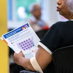 photo: A jobseeker holds an information packet during a U.S. Census Bureau 2020 job opportunities workshop in 2019.