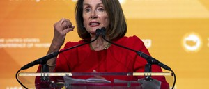 U.S. House Speaker Nancy Pelosi speaks from a podium