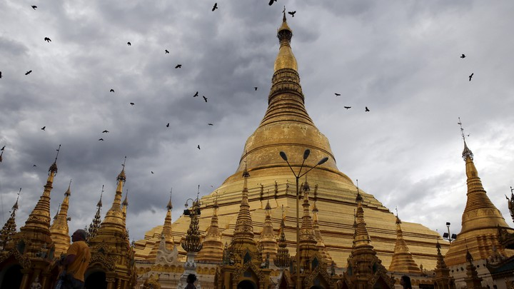 The Shwedagon Pagoda in Yangon, Burma, on a cloudy day