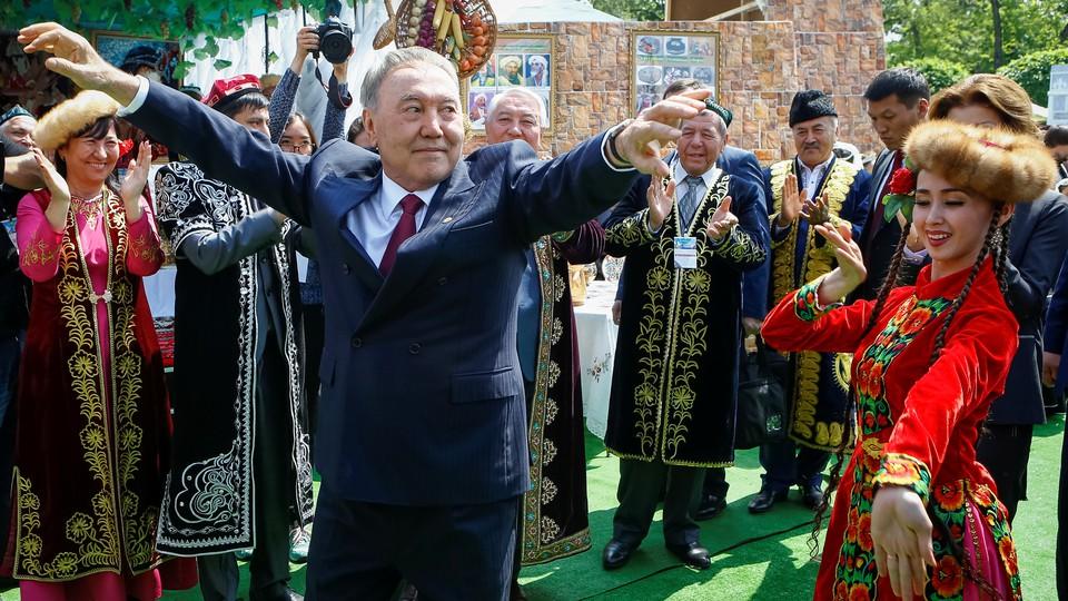 Former Kazakh President Nursultan Nazarbayev dances at a celebration for Kazakhstan People's Unity Day in 2016.