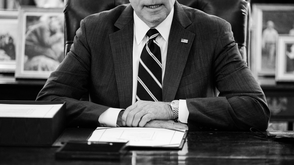 President Joe Biden signs the American Rescue Plan on March 11 in the Oval Office.