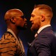 Floyd Mayweather and Conor McGregor appear in a press conference in London.
