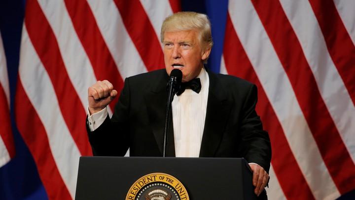 President Tump speaking at a podium