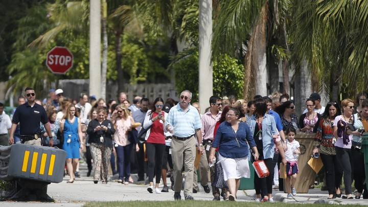 People evacuate a Jewish Community Center and day school in Florida on February 27. This particular community center was not among those Juan Thompson allegedly threatened.