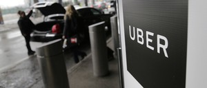 An Uber pulls up to a curb at New York's LaGuardia airport.