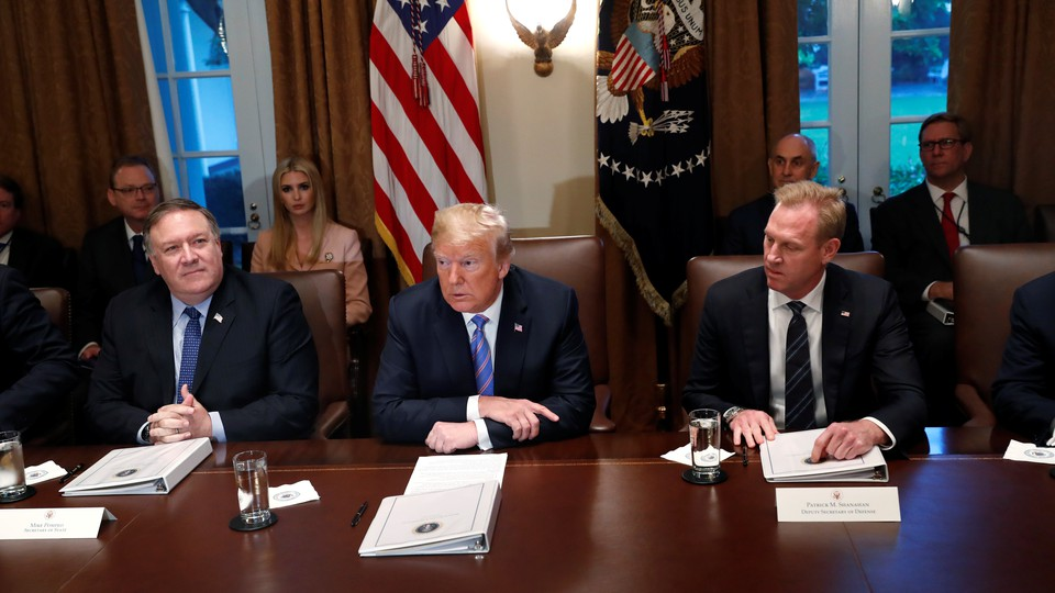 Trump meets with Secretary of State Mike Pompeo and acting Defense Secretary Patrick Shanahan in July.