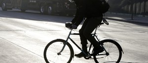 a photo of a Minneapolis bike rider in winter