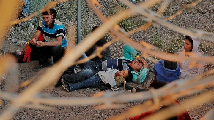 Migrants being held by U.S. Customs and Border Protection (CBP), after crossing the border between Mexico and the United States illegally and turning themselves in to request asylum, in El Paso, Texas, on March 29, 2019