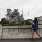 a photo of a pedestrian near Notre Dame Cathedral in Paris.