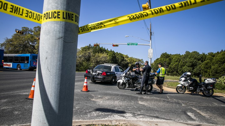 Police tape marks off a neighborhood street in Austin, Texas.