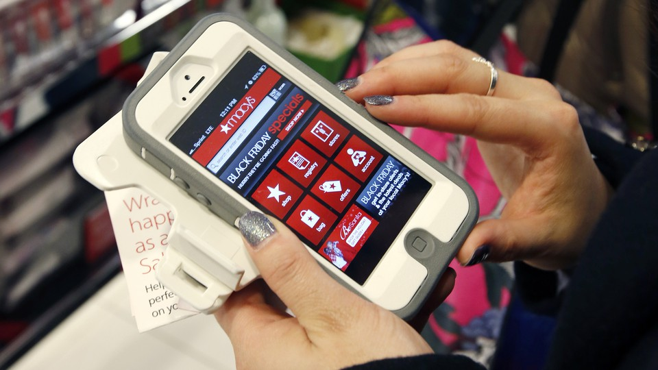 A person shops on a smartphone.