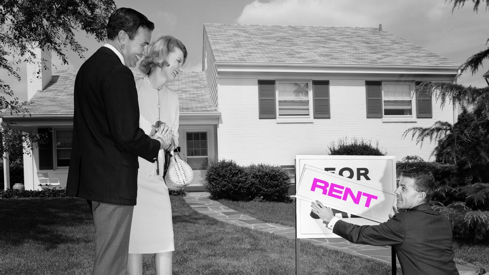 """A photo of a couple looking at a """"For Rent"""" sign."""