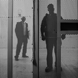 A view of prison employees from inside a cell in the Secured Housing Unit at Pelican Bay State Prison in Crescent City, California, in February 2012