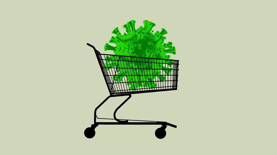 An illustration of a green coronavirus nestled inside a supermarket cart