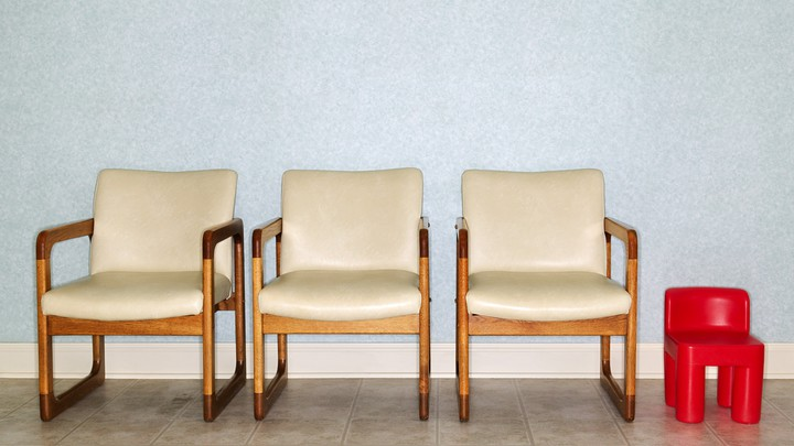 Adult chairs and a child's chair in a clinic waiting room
