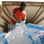 Danny McFadden, of Phoenix, a driver for AZ Iceman, loads up a pallet of bagged ice as temperatures were predicted to hit 115 during a heat wave in July 2007.