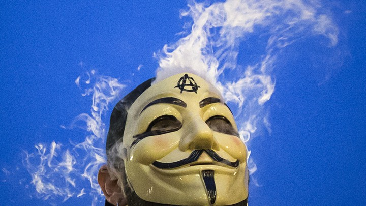 Member of Anonymous movement wearing Guy Fawkes mask