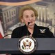 Madeleine Albright stands at a Department of State podium.