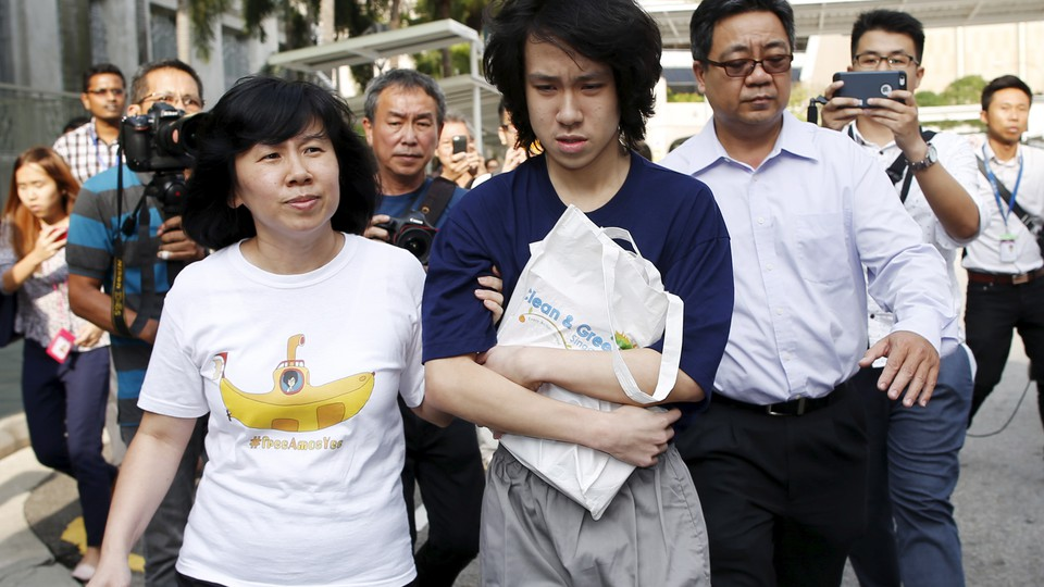 Teen blogger Amos Yee leaves with his parents after his sentencing from the State Court in Singapore July 6, 2015.