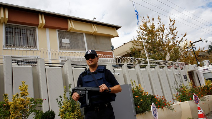A police officer stands guard in front of the Israeli Embassy in Ankara, Turkey, September 21, 2016.