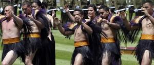 Māori warriors in traditional dress perform the haka.