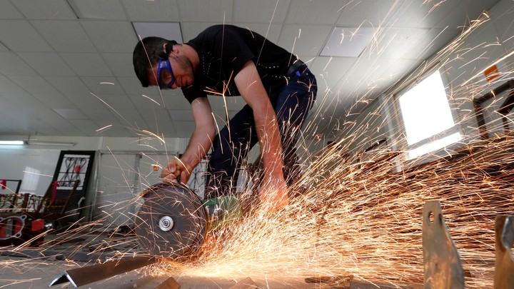 A man working with metal