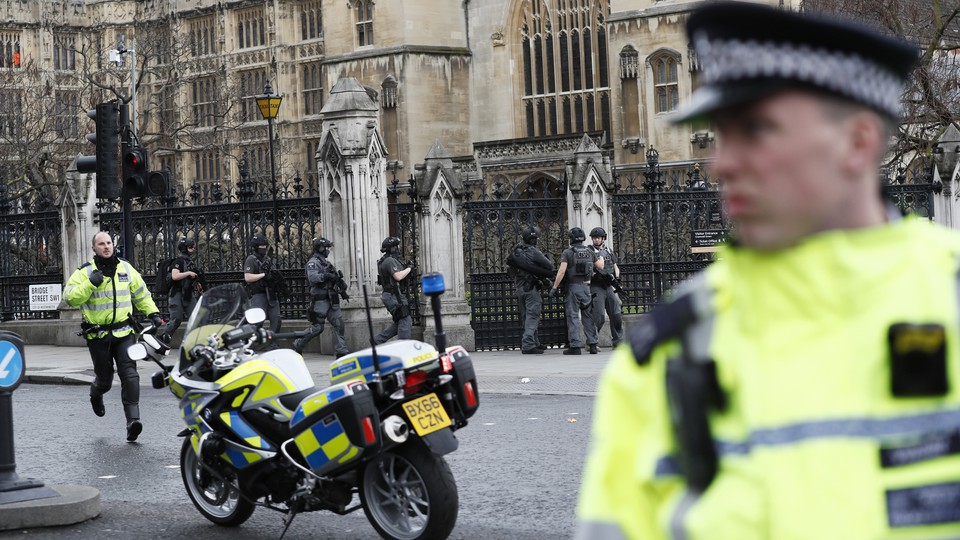 Armed police respond outside Parliament during an incident on Westminster Bridge in London, Britain March 22, 2017.