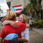 Mayor of San Juan Carmen Yulin Cruz embraces a city administrator.